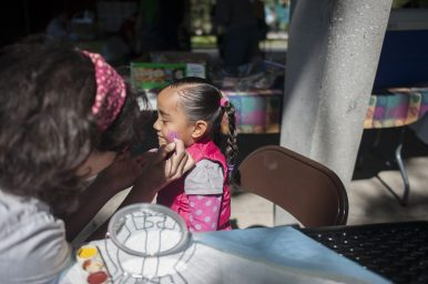 Molina Diaz, gets her face painting during the annual Meet the Creek event. | William Camargo/Staff Photographer