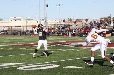 Fenwick senior Gavin Graves throws a pass against Montini on Saturday, Oct. 17 at Morton West High School. The visiting Broncos defeated the Friars 48-7. (Photo by Marie Lillig)