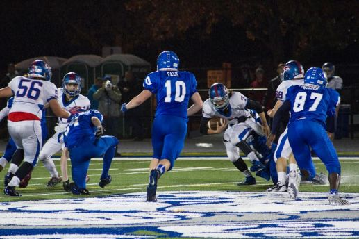 Sam Falk, #10, bares down on a Glenbard South player during the Bulldogs' 35-21 win against the visiting Raiders on Friday, Oct. 23. (Stacey Rupolo/Contributing Photographer)