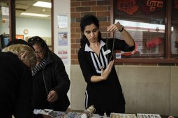 Ada Xhuba looks at a necklace from a vendor at the North Riverside Holiday Arts and Crafts Fair at the Village Commons on Nov. 7. | William Camargo/Staff Photographer
