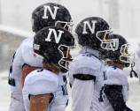 Several Nazareth football players watch the snow-filled action during the Roadrunners' 34-0 win against host St. Laurence in the Class 5A semifinals on Saturday, Nov. 21. (Courtesy Nazareth Academy)