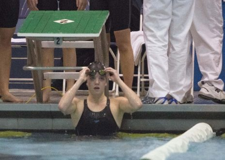 Fenwick senior Theresa Mullen waits for her team's time to be posted for the 200-yard medley relay at the 2015 IHSA State Swimming & Diving Championship on Saturday, Nov. 21, 2015. |Jennifer T. Lacey/Contributor