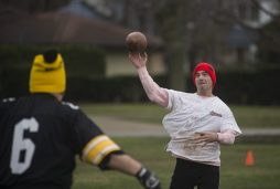Patrick Callaghan throws a pass to one of his teammates during the Cameron Can Turkey Bowl at Big Ball Park. | William Camargo/Staff Photographer