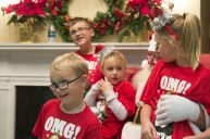 Abel Smith, 4, A.J. Smith, 9, Alivia Smith, 5, and Audrey Smith, 8, sit with Santa. | Michelle Kanaar/Contributor