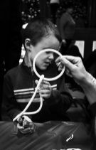 A child tries to solve how the Magician fitted the rope through the solid ring. | Arturo Hidalgo/Contributor