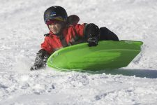 Ethan DiMaano, 10, shreds his way down the sled hill at Swan Pond park on Monday, Feb. 3, 2015. | Chandler West/File