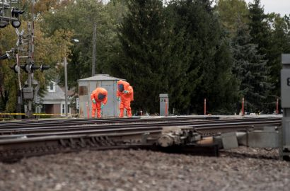Firefighters in HAZMAT suits collect samples from the crossing at Maple Avenue in Brookfield on Oct. 12. The incident stopped train and vehicle traffic for hours.   William Camargo/Staff Photographer