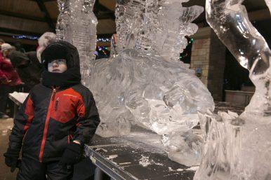 Fabian B. age 5, of Chicago, poses next to an ice sculpture.   Rick Majewski/Contributor