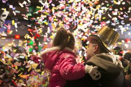 """A father holds his daughter as the confetti flies at """"midnight"""" ??%u2014 actually 8 p.m. ?%u2014 at Broofield Zoo's Zoo Year's Eve party for families on Dec. 31.   Rick Majewski/Contributor"""