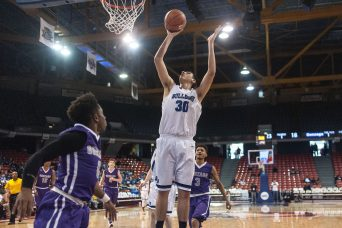 6-foot-7 senior center Mark Smith provides the Bulldogs with a much-needed and strong interior presence. (File photo)