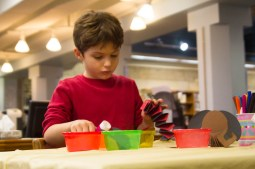 Maximus Martinez, 7, makes a dog at the Riverside Library. | Stacey Rupolo/Contributor