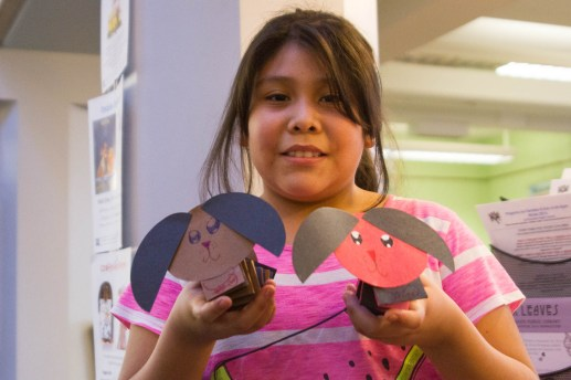 Alicia shows off dogs she made as part of a winter reads program at the Riverside Library. | Stacey Rupolo/Contributor