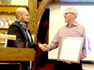 Peter Boutsikakis (left) accepts the Olmsted Spirit Award from Olmsted Society President Rob Dixon during the society's annual meeting at the Riverside Public Library on Jan. 22. | Submitted