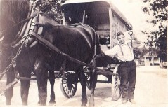 A man delivering a block of ice for the Speidel Coal and Ice Co.