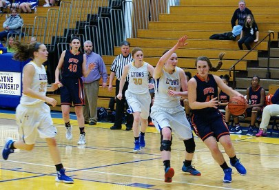 OPRF sophomore Maeve Nelson drives to the basket with LTHS center Emily Pender looking to block her shot. (File photo)