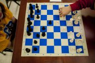 A chess player makes a move during the annual St. Mary School Golden Bishops Chess Club and Chess Scholars Chess Tournament on Saturday, Feb. 13. | William Camargo/Staff Photographer