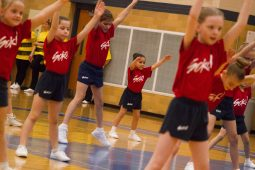 First and second grade girls perform a calisthenics routine at the 12th Annual Sokol Spirit Exhibition at Riverside-Brookfield High School on March 5. | Stacey Rupolo/Contributor