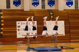 The men's gymnastics team does a bar routine during the 12th Annual Sokol Spirit Exhibition at Riverside-Brookfield High School on March 5. | Stacey Rupolo/Contributor