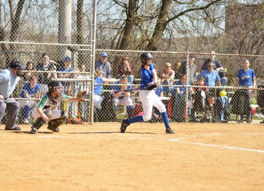 RBHS sophomore Tori Blood tracks a pitch she hit for a home run against York during a doubleheader on Saturday, April 16 at Veterans Park in North Riverside. (Submitted photo)