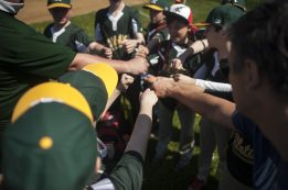 The A's celebrate their win for league opener of little league in Riverside on April 16. | William Camargo/Staff Photographer