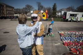 Hauser Junior High School mascot hugs Diane Palka as she brought canned food for the food drive that took place in Riverside, on April 16. | William Camargo/Staff Photographer