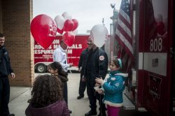 Firefighters handed out balloons to children that participated in the annual Transportation Exploration Day outside the North Riverside Village Commons on April 28.   William Camargo/Staff Photographer