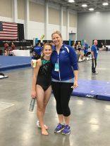 Artistic gymnast Amanda Gruber with coach Kacey Childs. (Photo by DeAnn Gruber)