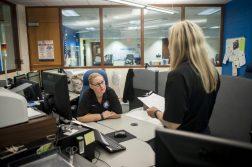 Gina Plastiak chats with her co-worker Jennifer Gallion at the North Riverside dispatch center. | William Camargo/Staff Photographer