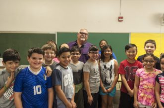 Tom Criscione, principal of Komarek School, with a class on May 26. Criscione will be retiring at the end of the school year. | William Camargo/Staff Photographer