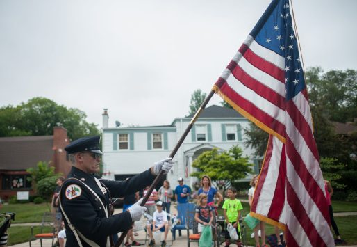 Frank Ringo holds the American flag as he leads the parade in Riverside on 4th of July. | WILLIAM CAMARGO/Staff Photographer
