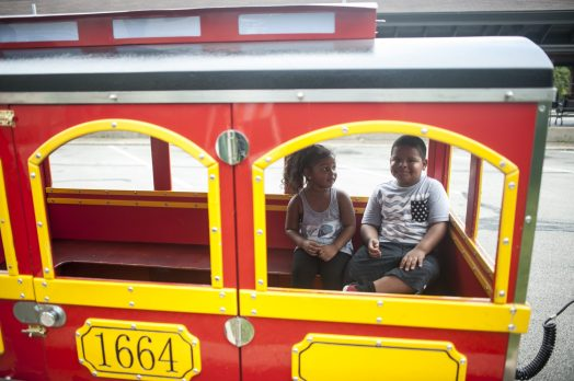 Brianna and Jason Cummings enjoy a train ride at the Chamber of Commerce's RiverFest in downtown Riverside on July 23. | William Camargo/Staff Photographer