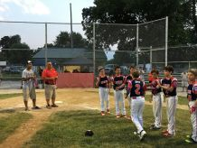 Liam Smith is congratulated by his Riverside 11U teammates as he heads towards home plate to receive a medal. (Submitted photo)