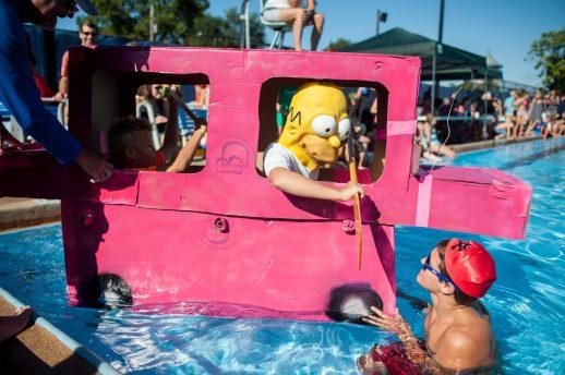 "Alec Wilkowski dressed as Homer Simpson inside his ""station wagon"" boat at the 3rd Annual Cardboard Boat Regatta at the Riverside Swim Club. | William Camargo/Staff Photographer"
