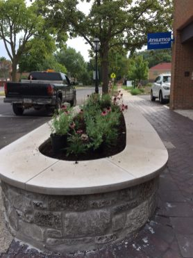 Plants await placement in one of the raised planters. | BOB UPHUES/Staff
