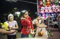 Gianna Zundell tries winning a prize at one of the carnival games. | William Camargo/Staff Photographer