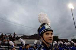 Eric Robertson, a junior at Riverside-Brookfield High School, preps to march with his fellow marching band members during the school's homecoming football game.   Sebastian Hidalgo/Contributor