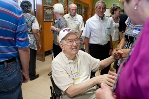 Joseph Lis greets former students and well-wishers after a ceremony dedicating a new science lab in his name at S.E. Gross Middle School in Brookfield in 2013. Lis was a beloved science teacher at Gross from 1956 to 1993. | File 2013