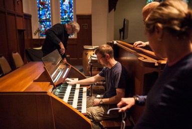 Organ tuner Martin Hill gives the newly refurbished organ a workout in preparation for the Oct. 30 rededication concert. | William Camargo/Staff Photographer