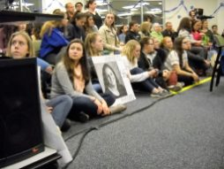 Students supporting RBHS teacher Jill Musil crowded the District 208 school board meeting on Feb. 28. Some held signs, like this one, with Musil's her photo on it. (Photo by Bob Skolnik)