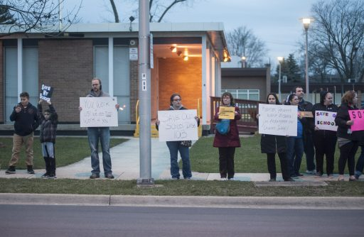 In the wake of a last-minute cancellation of a school board meeting, parents in Lyons-Brookfield School District 103 organized a last-minute protest in front of the administration building in Lyons on Thursday night March 23. (William Camargo|Staff)