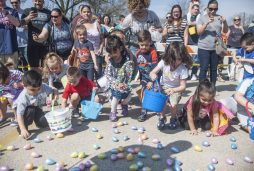Children rush to collect plastic eggs filled with treats at the North Riverside Policeman's Benevolent and Protective Association's annual Easter Egg Hunt on April 15 in North Riverside. | William Camargo/Staff Photographer
