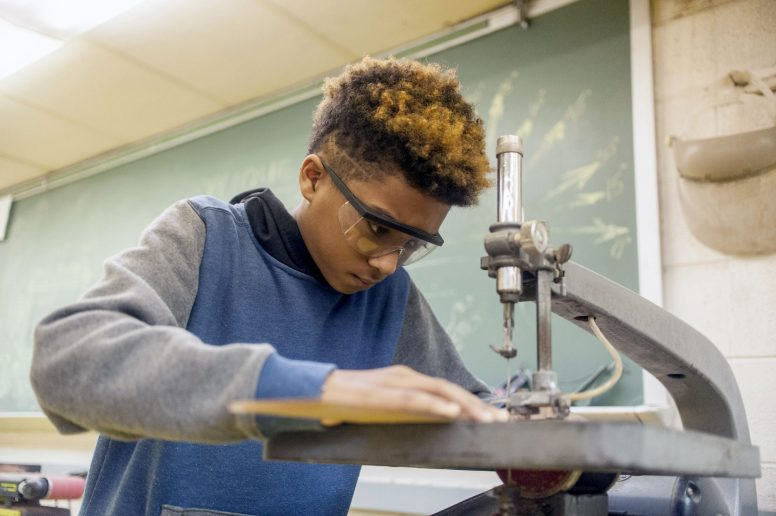 Darius Moore uses a scroll saw during shop class at Komarek School in North Riverside in March. The class is required for middle school-age kids at Komarek, along with home economics, classes that are disappearing from elementary schools elsewhere.   William Camargo/Staff Photographer