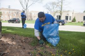 Steve and Nicholas Marchese clean up around Kiwanis Park in Brookfield during the village's spring Project NICE community cleanup event on April 22. | William Camargo/Staff Photographer