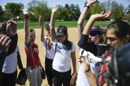 The softball team gathers together before the start of the Riverside Little League softball game at Big Ball Park on Longcommon Road. | William Camargo/Staff Photographer