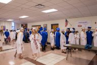 Seniors hang out in the cafeteria before the commencement ceremony at Riverside-Brookfield High School on May 26. | Jason Schumer/Contributor