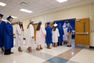 Graduating seniors enter the gym to receive their diplomas during graduation ceremonies at Riverside-Brookfield High School on May 26. | Jason Schumer/Contributor