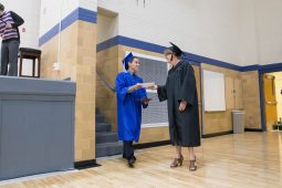 Alexandro A. Zuniga receives his diploma during the commencement ceremony at Riverside-Brookfield High School on May 26. | Jason Schumer/Contributor