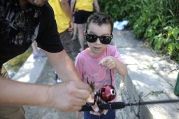 Robby Salinas looks at his small crab he caught from the bank in Swan Pond Park in Riverside during the Recreation Department's first-ever kids' fishing derby on June 11. About 40 kids and their parents showed up to fish on a day where temperatures reached into the 90s. | William Camargo/Staff Photographer