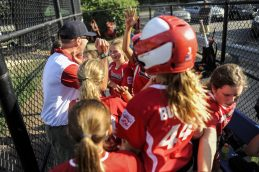 Members of Riverside Little League's 12-U softball squad talk strategy in the dugout during their game against LaGrange on July 7 at Veterans Park in North Riverside. | William Camargo/Staff Photographer
