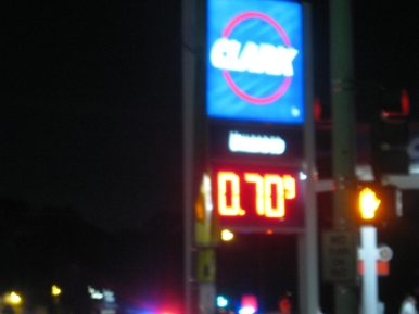 The price of gas hit its lowest level of the night at 70 cents a gallon at the Clark station at 3045 Maple Ave. on July 15. By 9:45 p.m., both stations called a truce and prices rose back above a gallon. (Photo courtesy of Steven Lifka)